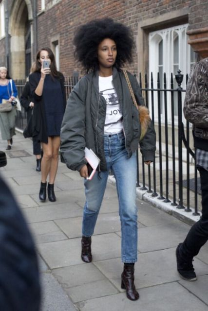 With labeled t shirt, cropped jeans, fur bag and boots