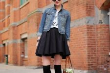 With labeled t-shirt, denim jacket, brown tote bag, black socks and shoes