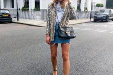 With labeled t-shirt, denim mini skirt, black bag and black ankle strap shoes