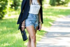 With labeled t-shirt, navy blue blazer, denim shorts and clutch
