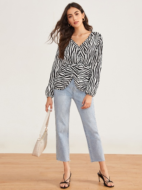 With light blue cropped jeans, white bag and black high heels