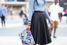 With light blue cropped shirt, printed clutch and black pumps