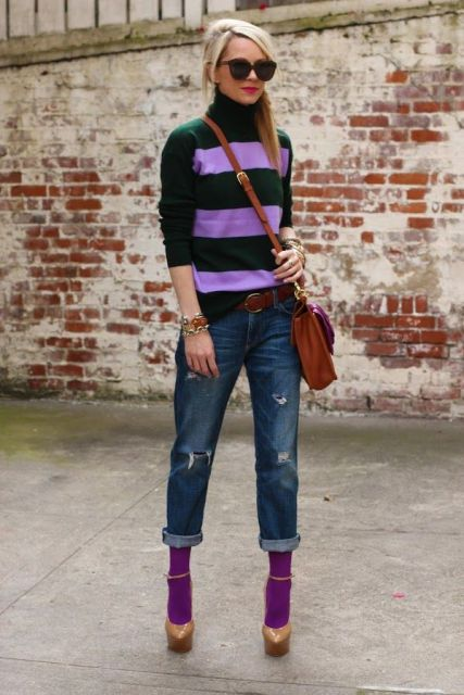 With lilac and green sweater, cuffed jeans, platform shoes and crossbody bag