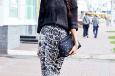 With loose sweater, black clutch and ankle strap shoes