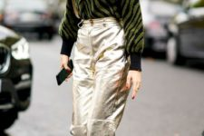 With metallic pants, embellished mules and bag