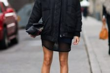 With mini dress, clutch and cutout boots