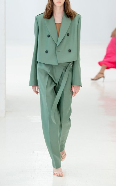 With mint green loose trousers, beige shoes and brown shirt