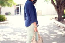 With navy blue shirt, beige tote bag and platform sandals
