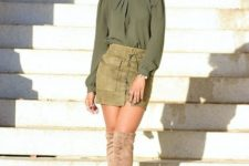 With olive green blouse and beige over the knee boots