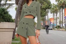 With olive green wrapped skirt and printed tote bag