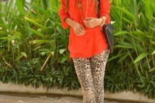 With orange blouse, black bag and black platform high heels