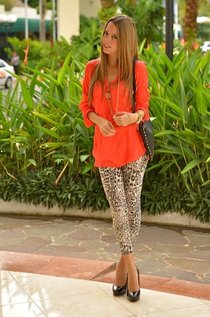 With orange blouse, black bag and black platform high heels