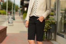 With polka dot blouse, beige blazer and black shorts