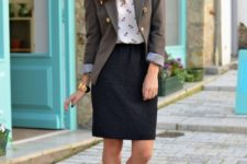 With printed blouse, gray blazer and yellow pumps