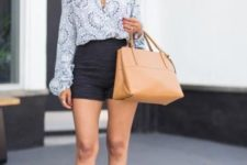 With printed blouse, shorts and beige bag