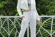 With printed lace crop blouse, white trousers and high heels