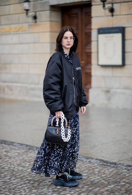 With printed maxi dress, black sneakers and black unique bag