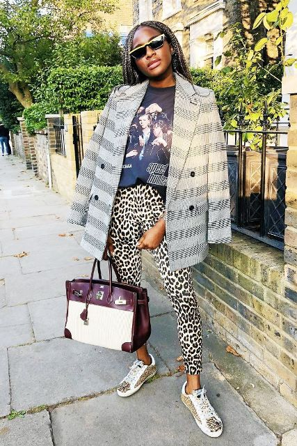 With printed t shirt, two colored bag, checked oversized blazer and printed flat shoes