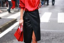 With red wrapped blouse, red bag and black lace up high heels