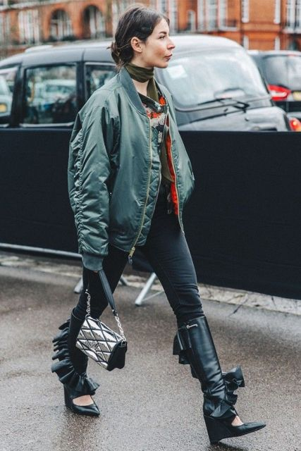 With shirt, pants, black high boots, silver bag and olive green scarf