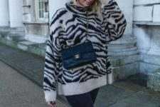 With skinny jeans, black chain strap crossbody bag and beige boots