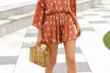 With straw bag and beige sandals