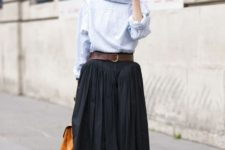 With striped shirt, brown belt, brown bag, lilac socks and embellished shoes