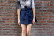 With striped shirt, denim skirt and red shoes
