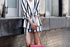 With striped suit, white shirt and red bag