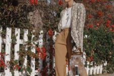 With white blouse, beige wide leg trousers, transparent bag and gray shoes