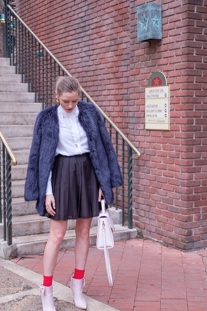 With white blouse, faux fur coat, white bag and pastel colored ankle boots