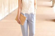 With white lace sleeveless top, beige clutch and ankle strap shoes