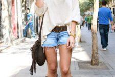 With white loose shirt, denim shorts, belt and fringe bag