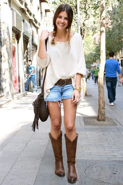 With white loose shirt, denim shorts, belt and fringe bag