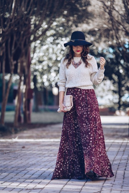 With white loose sweater, wide brim hat, clutch and black shoes