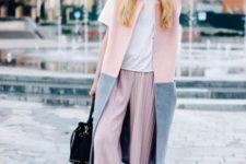 With white loose t-shirt, gray and pink long vest, black backpack and black cutout boots