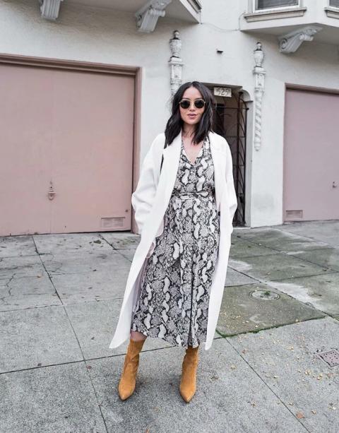 With white maxi coat, bag and brown suede mid calf boots