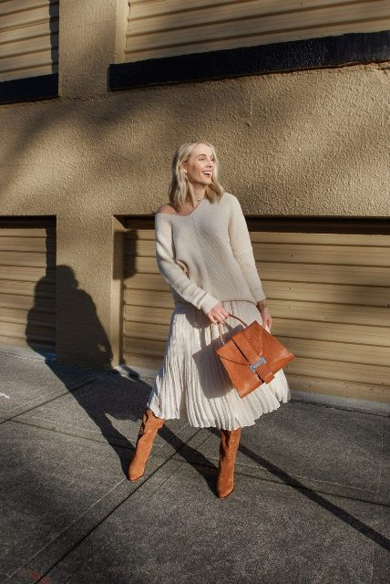 With white one shoulder sweater, brown suede boots and brown bag