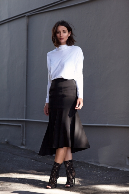 With white shirt and black cutout ankle boots