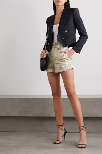 With white shirt, beige shorts, chain strap bag and lace up high heels