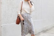 With white shirt, red rounded bag and brown sandals