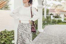 With white sweater, marsala bag and white mid calf boots