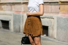 With white t-shirt, black bag and lace up flat sandals