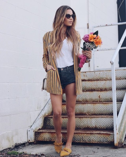 With white t-shirt, denim shorts and striped long blazer