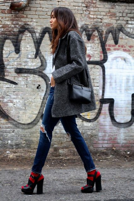 With white t shirt, gray coat, distressed jeans, black bag and black sandals