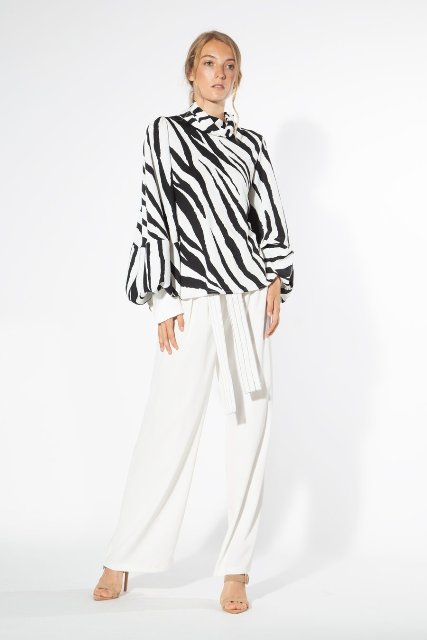 With white wide leg pants and beige shoes