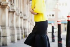 With yellow blouse and printed pumps