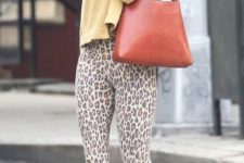 With yellow crop sweater, brown bag and black sandals