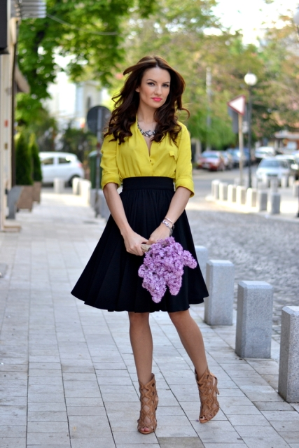 With yellow shirt and brown lace up high heels