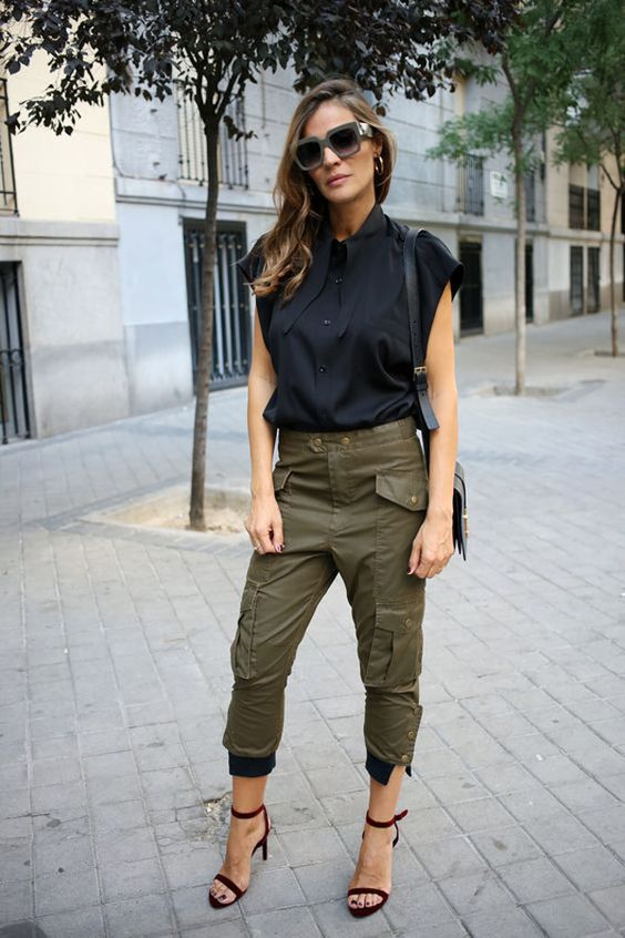 a black blouse, green cargo pants, burgundy shoes and a black bag for a trendy summer outfit